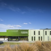 :Green mesh and patterned, pigmented green concrete envelope architecture, campus, cloud, corporate headquarters, daytime, estate, facade, grass, headquarters, home, house, property, real estate, sky, blue