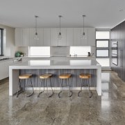 In this house built by Starr Constructions, waterfall-end, cabinetry, countertop, cuisine classique, floor, flooring, interior design, kitchen, room, gray
