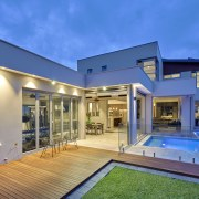 Indoor-outdoor flow and generous living spaces are features architecture, backyard, elevation, estate, facade, home, house, property, real estate, residential area, roof, swimming pool, villa, window, blue