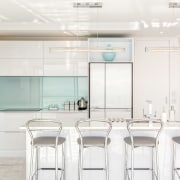 A green back-painted glass splashback complements the interiors furniture, interior design, kitchen, product design, table, white