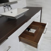 In this bathroom, two u-shaped drawers below the countertop, floor, furniture, plumbing fixture, product design, sink, table, tap, wood, gray