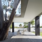 This expansive deck adds the functionality of a architecture, estate, home, house, interior design, outdoor structure, property, real estate, tree, white, black