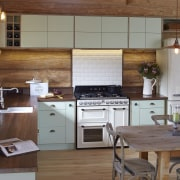 The cabinetry in this log cabin has been cabinetry, countertop, cuisine classique, interior design, kitchen, room, brown, gray