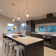 This GJ Gardner home has a large family countertop, interior design, kitchen, real estate, room, gray