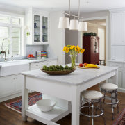 In this renovation project by designer Jan Goldman, countertop, dining room, furniture, home, interior design, kitchen, living room, room, table, white, gray