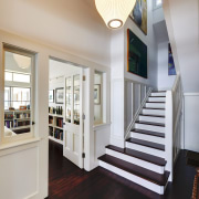 In this renovation project, natural light floods the ceiling, daylighting, estate, floor, flooring, hardwood, home, interior design, real estate, stairs, window, wood flooring, gray