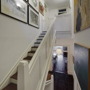 Wooden stair treads and traditional-look panelling help merge floor, handrail, interior design, real estate, stairs, gray