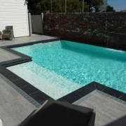 Above: This sparkling Mayfair pool in the evocative floor, leisure, property, swimming pool, water, water feature, wood, black