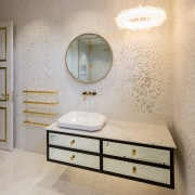 Gold touches add colour and a sense of architecture, bathroom, bathroom accessory, bathroom cabinet, beige, cabinetry, ceiling, chest of drawers, countertop, drawer, floor, flooring, furniture, interior design, lighting, mirror, property, room, sink, tile, wall, gray