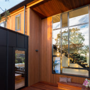 Black and tan  black fibrous cement meets architecture, deck, facade, home, house, interior design, real estate, siding, window, wood, wood stain, brown
