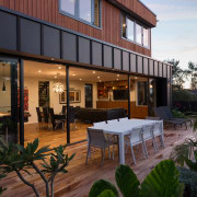 This living-kitchen-dining pavilion steps down from the rest apartment, estate, home, house, property, real estate, residential area, black, brown