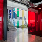 A red-glazed wind lobby offers an example of architecture, door, interior design, lobby, window, red, gray