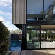 Tranquility base  this house exudes a tranquil apartment, architecture, building, condominium, daylighting, facade, home, house, interior design, real estate, reflection, window, black