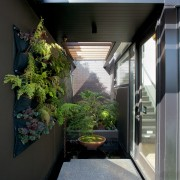 Large steps and an ornamental pond provide a architecture, courtyard, home, house, window, black, gray