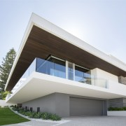 The living floor of this seaside house by architecture, building, commercial building, corporate headquarters, elevation, facade, home, house, official residence, property, real estate, residential area, villa, white