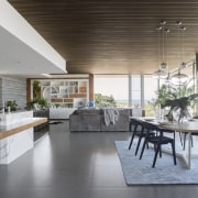 Entry into this living area is via a architecture, house, interior design, living room, real estate, gray