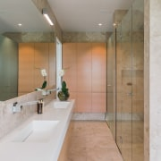 This long, narrow bathroom has the toilet at architecture, bathroom, floor, interior design, room, tile, gray
