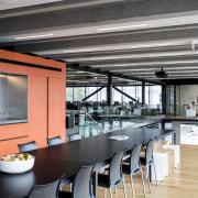 In Warren and Mahoneys new offices, elements like interior design, loft, gray, black