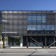 Steel structures are on prominent display within the architecture, building, commercial building, corporate headquarters, daytime, facade, headquarters, metropolis, metropolitan area, mixed use, residential area, sky, structure, black, blue