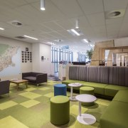Maps and inspirational graphics are used prominently for ceiling, conference hall, daylighting, interior design, lobby, office, waiting room, gray