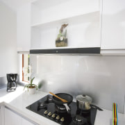 This cooktop  by Eisno  contrasts and countertop, interior design, kitchen, product design, room, shelf, shelving, white