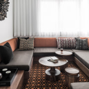 Warm tones and patterns create a cosy ambience couch, furniture, interior design, living room, room, table, white