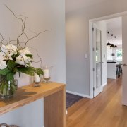 This home achieves a light, airy appeal in floor, flooring, home, interior design, property, real estate, room, gray