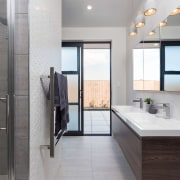 This master suite opens to a private spa bathroom, floor, interior design, real estate, room, gray