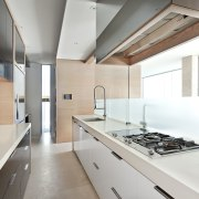 This kitchens middle cooking zone includes a hob, architecture, countertop, interior design, kitchen, real estate, white