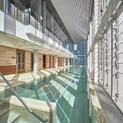 The Perth Como hotels Travertine lap pool is apartment, architecture, building, condominium, daylighting, leisure centre, structure, white, gray