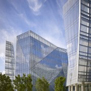 The facade on the new FBI headquarters changes architecture, building, city, commercial building, condominium, corporate headquarters, daytime, facade, headquarters, landmark, metropolis, metropolitan area, mixed use, real estate, reflection, sky, skyscraper, tower block, urban area, teal