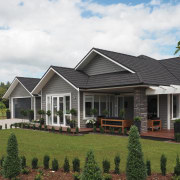 Finishes on this home include Resene Half Masala cottage, elevation, estate, facade, farmhouse, home, house, landscape, neighbourhood, property, real estate, residential area, roof, siding, villa, window, white, brown