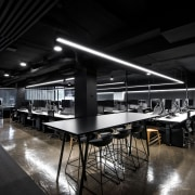 For this fit-out, original concrete floors were retained architecture, ceiling, interior design, table, black