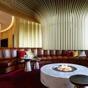 The Canberra Airport Hotel's signature round, curving theme architecture, ceiling, interior design, lighting, lobby, restaurant, table, red, brown