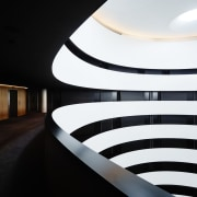 The Canberra Airport Hotel's darkened corridors afford guests architecture, ceiling, daylighting, light, lighting, line, product design, black, white