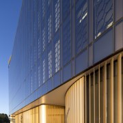 Gold-coloured louvres at ground level on the exterior architecture, building, commercial building, condominium, convention center, corporate headquarters, daylighting, daytime, facade, headquarters, line, metropolitan area, mixed use, real estate, residential area, sky, structure, blue