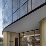 The entry to the Canberra Airport Hotel is architecture, building, commercial building, daylighting, facade, house, gray