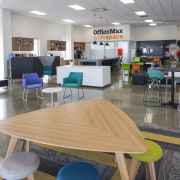 The Christchurch OfficeMax workspace store includes bright and chair, classroom, furniture, institution, interior design, office, table, gray