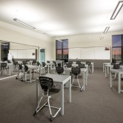 Having few pinboards in this classrooms plays down institution, office, real estate, white, gray