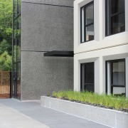 For Aucklands new student village, the custom concrete architecture, building, condominium, estate, facade, home, house, property, real estate, residential area, wall, window, gray