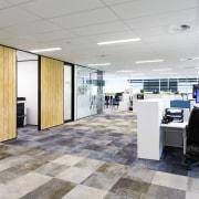 Canam Construction undertook several aspects of the new floor, flooring, interior design, lobby, office, gray