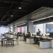 A feeling of space and light pervades the interior design, office, black, gray