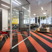 The NZME offices are open-plan with no separate flooring, interior design, lobby, gray, black