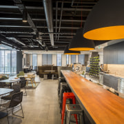 Areas of the NZME  new premises have ceiling, interior design, restaurant, table, black