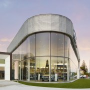 For the design of this upmarket car showroom, architecture, building, commercial building, condominium, corporate headquarters, facade, headquarters, mixed use, real estate, gray, blue