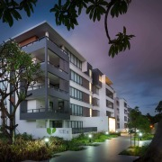 Located near the entry to Putney Hill, Figtree apartment, architecture, building, condominium, estate, facade, home, hotel, house, mixed use, property, real estate, residential area, sky, tree, black
