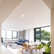 The one, two, and three-bedroom homes in Jacara architecture, ceiling, daylighting, home, house, interior design, living room, real estate, window, white