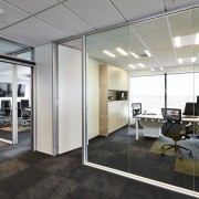The glass-walled offices at Powell Fenwick House evoke ceiling, floor, flooring, interior design, office, real estate, window, gray, black
