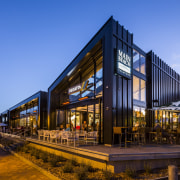 Main Beach Takapuna by Ignite Architects creates a architecture, building, evening, facade, home, house, mixed use, real estate, reflection, residential area, sky, teal