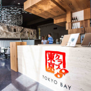 Features of Tokyo Bay restaurant include a hanging interior design, white